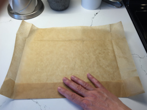 Trace the shape of your pan on a piece of baking parchment paper
